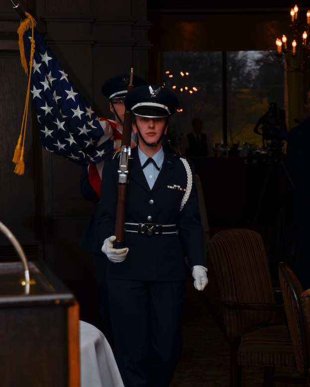 University of St. Thomas ROTC Detachment 410 cadets presents the U.S. flag during the Air Force Association's Annual Awards Dinner in St. Paul, Minn., Apr. 5, 2013. Airmen assigned to various commands around Minnesota were honored for their achievements during the ceremony. (U.S. Air Force photo by Staff Sgt. Amy M. Lovgren/Released)