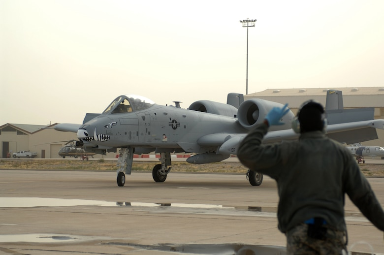 A crew chief from the 358th Fighter Squadron taxis in an A-10C Thunderbolt II from Barksdale Air Force Base, La. at Davis-Monthan AFB, Ariz., April 9, 2013. The Barksdale aircraft is being transferred to D-M to replace retiring A-10s. (U.S. Air Force photo by Airman 1st Class Betty R. Chevalier/released)