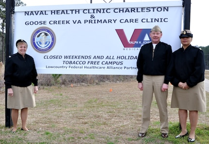 """(From right to left) Navy Capt. Mary Kim Kenney-Gutshall, Naval Health Clinic Charleston commanding officer, Capt. Richard Joralmon, NHCC executive officer and Master Chief Petty Officer Betty Watson, NHCC command master chief, unveil the NHCC directional signage which reads """"Tobacco Free Campus"""" at NHCC on Joint Base Charleston – Weapons Station, S.C., March 1, 2013. (U.S. Navy photo/Jeff Kelly)"""