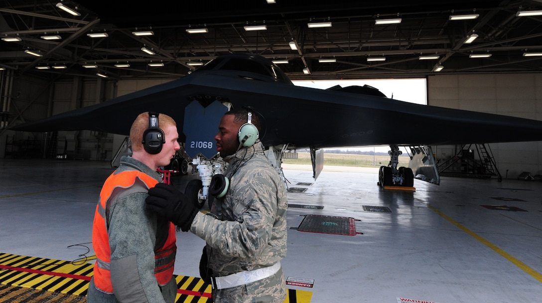 Airmen 1st Class James Fulton and Steven McCray and James Fulton, 13th Aircraft Maintenance Unit crew chiefs, discuss launch operations during a pre-flight inspection at Whiteman Air Force Base, April 5, 2013. Fulton and McCray are two of more than 160 crew chiefs that are responsible for ensuring each B-2 assigned to Whiteman Air Force Base is mission-ready. (U.S. Air Force photo by Staff Sgt. Nick Wilson/Released)