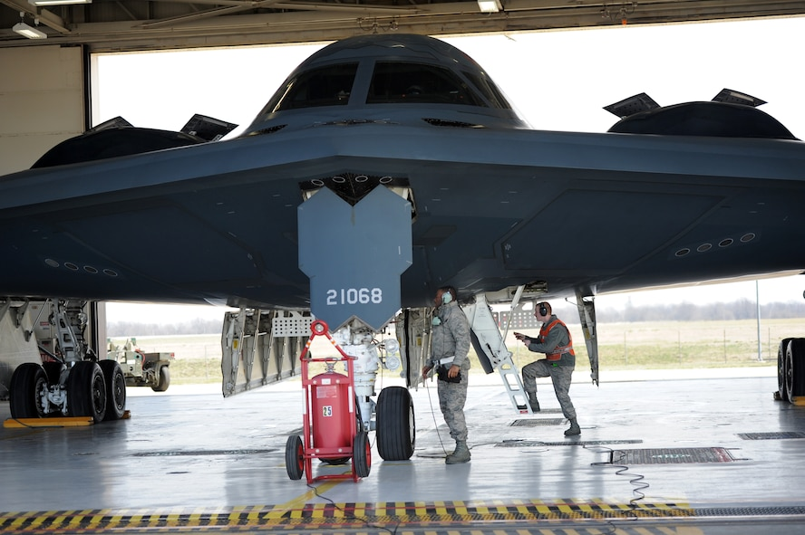 """Airman 1st Class Steven McCray, 13th Aircraft Maintenance Unit B-2 Spirit crew chief, and Airman 1st Class James Fulton, 13th Aircraft Maintenance Unit B-2 crew chief, perform pre-flight checks on the """"Spirit of New York"""" at Whiteman Air Force Base, April 5, 2013.  Because of their mission and constant operations tempo, B-2 crew chiefs must remain alert and aware of every maintenance issue on their assigned aircraft. (U.S. Air Force photo by Staff Sgt. Nick Wilson/Released)"""