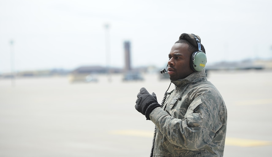 Airman 1st Class Steven McCray, 13th Aircraft Maintenance Unit B-2 Spirit crew chief, communicates with pilots during a pre-flight inspection, Whiteman Air Force Base, April 5, 2013. Crew chiefs from the 509th Aircraft Maintenance Squadron are responsible for inspecting, troubleshooting and maintaining Whiteman's B-2 Spirits, ensuring the aircraft are combat- ready to support global strike operations and nuclear deterrence. (U.S. Air Force photo by Staff Sgt. Nick Wilson/Released)