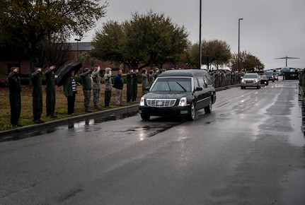 Airmen salute as the body of United States Army Chief Warrant Officer 5th Class Curtis Reagan, 43, of Summerville, S.C., passes by April 4, 2013, at Joint Base Charleston – Air Base, S.C. Reagan, 43, of Summerville, S.C., died March 29, 2013, in Kandahar, Afghanistan, from a non-combat related illness. Reagan's remains were flown from Dover, Del., to Charleston. (U.S. Air Force photo/ Senior Airman Dennis Sloan)