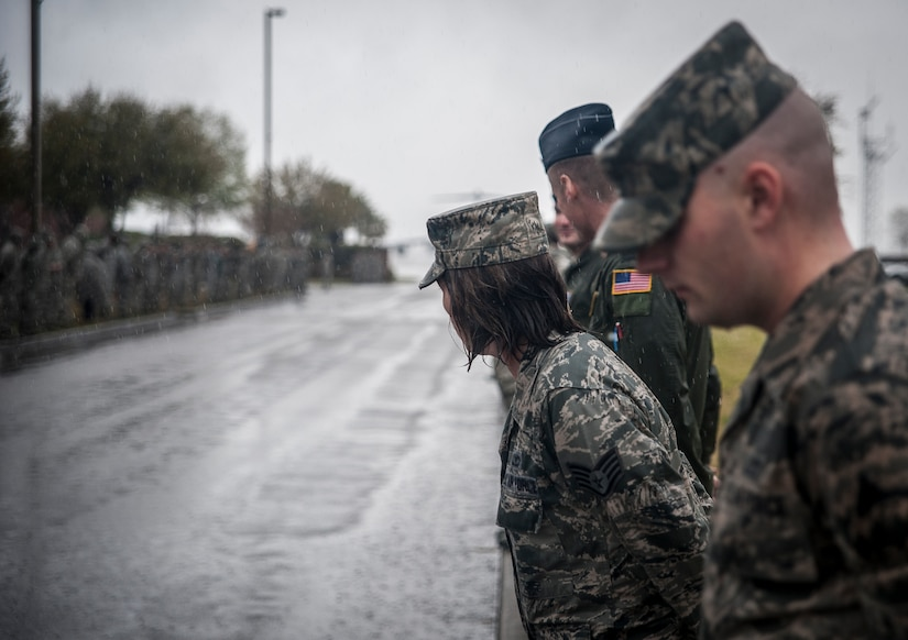 Airmen brave the rain and wind as they fall into formation along Hill Blvd. following  a Dignified Transfer ceremony April, 4, 2013,  at Joint Base Charleston – Air Base, S.C. The Airmen were showing their respect to U.S. Army Chief Warrant Officer 5th Class Curtis Reagan, 43, of Summerville, S.C., who died March 29, 2013, in Kandahar, Afghanistan, from a non-combat related illness. Reagan's remains were flown from Dover, Del., to Charleston. (U.S. Air Force photo/ Senior Airman Dennis Sloan)
