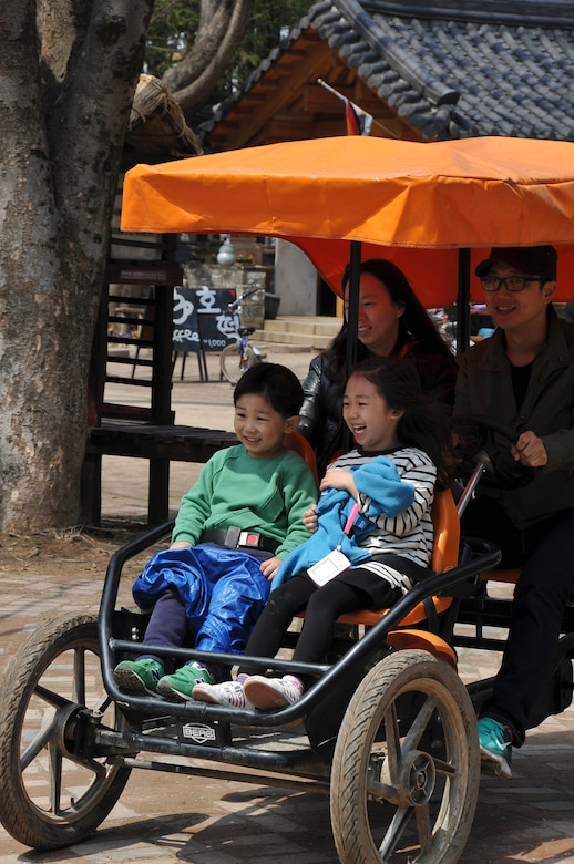 A Korean family enjoys an afternoon driving around Nami Island, Republic of Korea, in their four-person electric car April 8, 2013. The island has single, tandem or family bicycles, electric cars and electric tricycles available for rent. (U.S. Air Force photo/Senior Airman Kristina Overton)