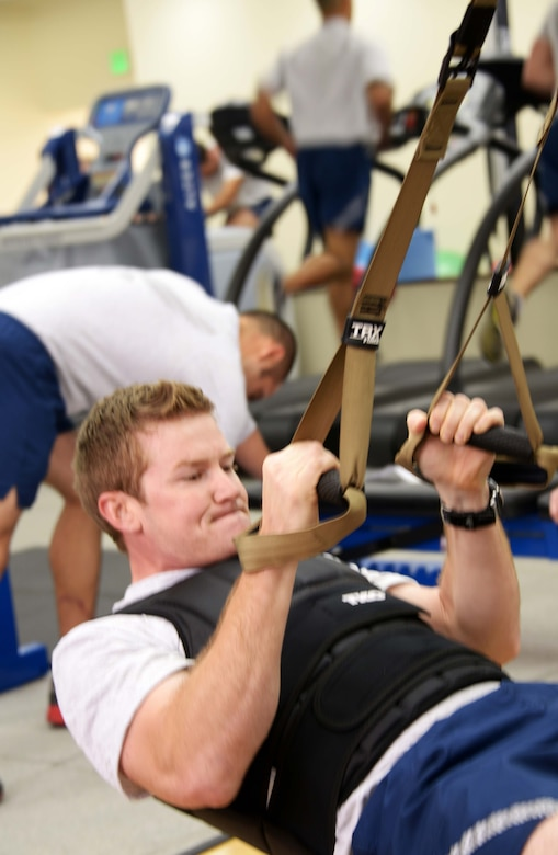 Staff Sgt. Patrick Harrington, 320th Special Tactics Squadron, works out in the Human Performance Training Center, during squadron physical training March 22 at Kadena Air Base.  The HPTC houses the human performance program, which focuses on not only strengthening the battlefield Airman physically, but also rehabilitating the individual ensuring the Air Force's human weapons system is performing to its maximum potential for as long as possible. (U.S. Air Force photo by Tech. Sgt. Kristine Dreyer)