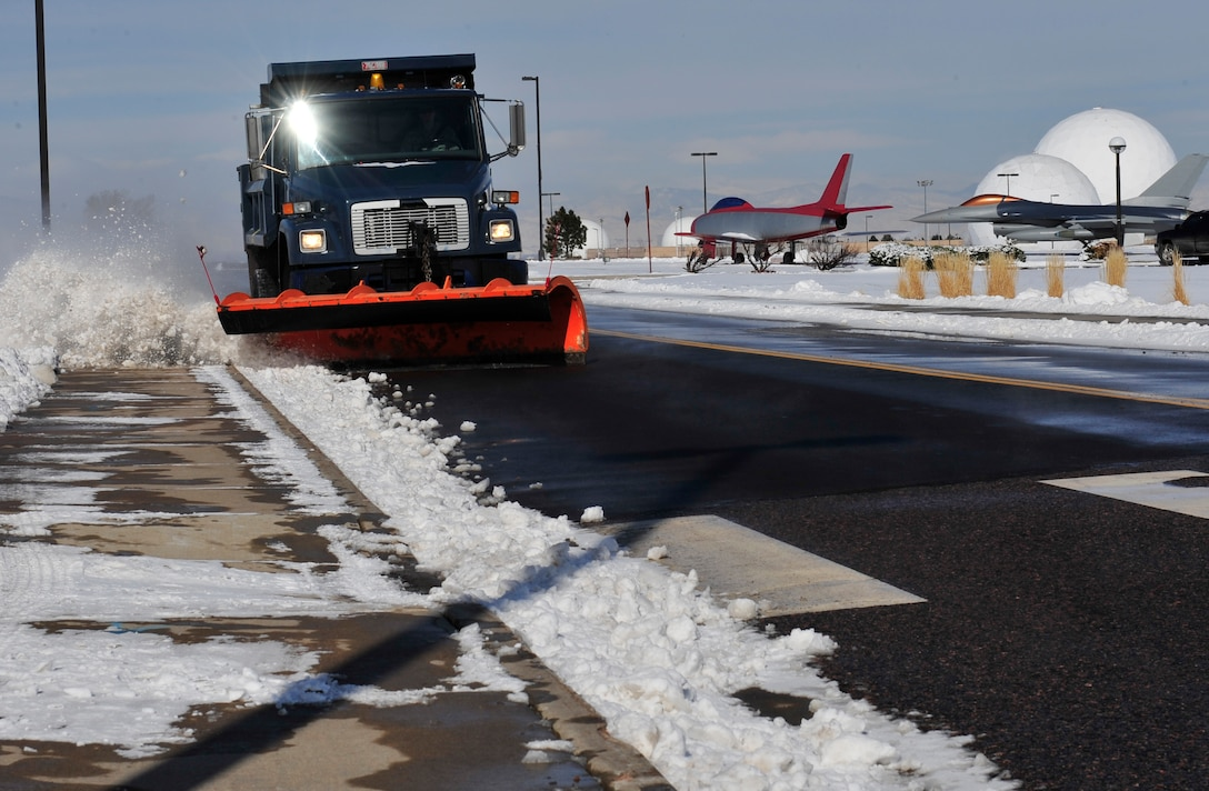 Airman 1st Class Jayce Yeager, 460th Civil Engineer Squadron heavy equipment operator, uses a snowplow to clear the road April 10, 2013, at Buckley Air Force Base, Colo.  The base received a reported 6 inches of snow during a 24-hour period. (U.S. Air Force photo by Airman 1st Class Darryl Bolden Jr./Released)
