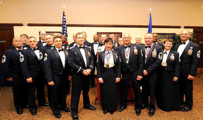 Col. Phil Stewart (middle front), 9th Reconnaissance Wing commander, and Chief Master Sgt. Robert White (far right), 9th Reconnaissance Wing command chief, pose with a collection of chief master sergeants near the end of the Chief Recognition Ceremony at the Recce Point Club on Beale Air Force Base, Calif., April 8, 2013. Chief Master Sgt. Geri Dreibelbis, 9th Security Forces Squadron security forces manager, Chief Master Sgt. Thomas Jenkins, 12th Aircraft Maintenance Unit superintendant, and Chief Master Sgt. Aaron Renn, 99th Aircraft Maintenance Unit superintendant, were recognized for achieving the highest enlisted rank. (U.S. Air Force photo by Airman 1st Class Bobby Cummings/Released)
