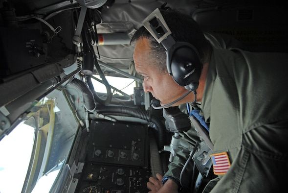 Master Sgt. Timothy Molder, boom operator with the 191st Air Refueling Squadron, manages the controls on a KC-135, preparing to refuel a KC-10 from Travis Air Force Base April 9, 2013.  (U.S. Air Force photo by A1C Emily Hulse/Released)