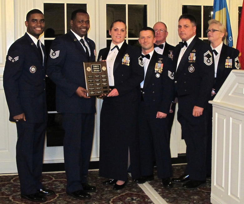 The Delaware Air National Guard recruiting team receives the Chief's Choice award from the Chief Master Sergeant's Council during the Delaware ANG Annual Enlisted Recognition Banquet held March 2, 2013 at the Deerfield Golf and Tennis Club in Newark, Del. For FY2012 the Delaware ANG gained 168 people, and finished the year with a retention rate of 91 percent and a re-enlistment rate of 94 percent. Overall end strength rose from 89.5 to 96.4 percent in the fiscal year. Left to right, front: Recruiting team members Senior Airman Desmond Overton, Tech. Sgt. Terrence Parker, Master Sgt. Tanya Harris, Tech. Sgt. Sam Lewis and Senior Master Sgt. Mike Davis. Standing at rear are Chief Master Sergeants Mike Forsyth and Patricia Ottinger. Not present: recruiter Tech. Sgt. Kristin Favors. (Air National Guard photo/Tech. Sgt. Benjamin Matwey)