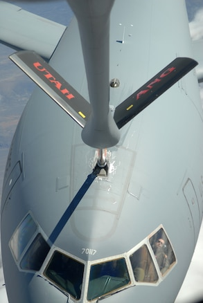 A KC-135 with the Utah Air National Guard 151st Air Refueling Wing refuels a KC-10 from Travis Air Force Base April 9, 2013.  (U.S. Air Force Photo by A1C Emily Hulse/Released)