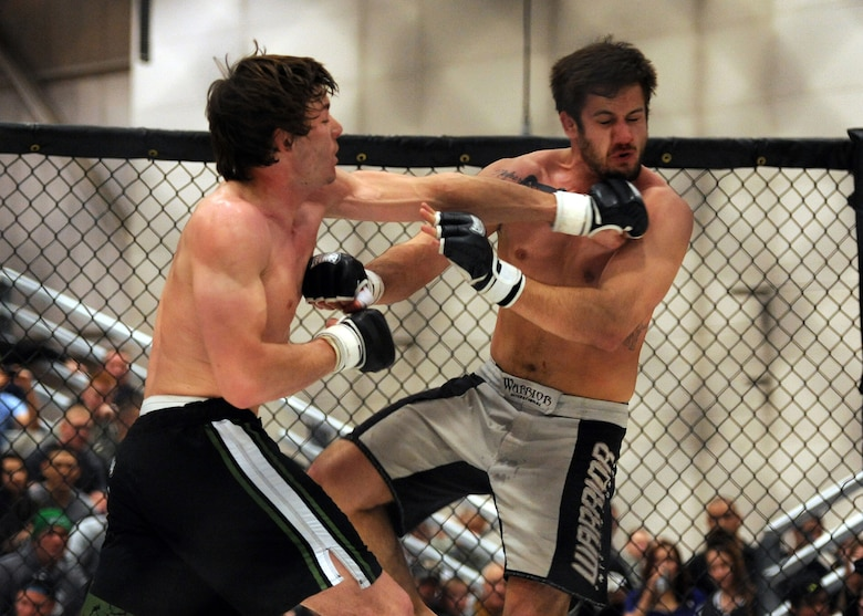 Mixed Martial Artist Ryan McCracken lands a left hook to the chin of opponent Stewart Langdon during an MMA fight April 5 at Malmstrom Air Force Base, Mont. McCracken won the matchup. (U.S. Air Force photo/Staff Sgt. R.J. Biermann)