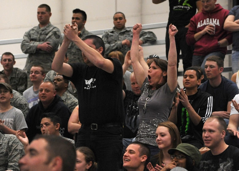 Team Malmstrom members applaud mix martial artists at the 3-Bay Hangar during a Fight for the Troops event on April 5. The first of its kind event brought 1,100 attendees. (U.S. Air Force photo/Airman 1st Class Katrina Heikkinen)