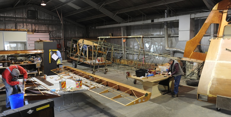 Waco glider restoration project volunteers work on a variety of parts at Whiteman Air Force Base, Mo., April 2, 2013. Whiteman was originally named Sedalia Army Air Field and was originally used as a training base for Waco glider pilots. (U.S. Air Force photo by Airman 1st Class Bryan Crane/Released)
