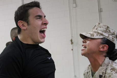 Sgt. Vanessa Soriano, a drill instructor from Marine Corps Recruit Depot Parris Island, S.C., motivates an officer candidate on April 6 during a Mini Officer Candidates School in Eastover, S.C. The Marines used the event to introduce candidates to the rigors of OCS. (Marine Corps Photo by Sgt. Aaron Rooks).