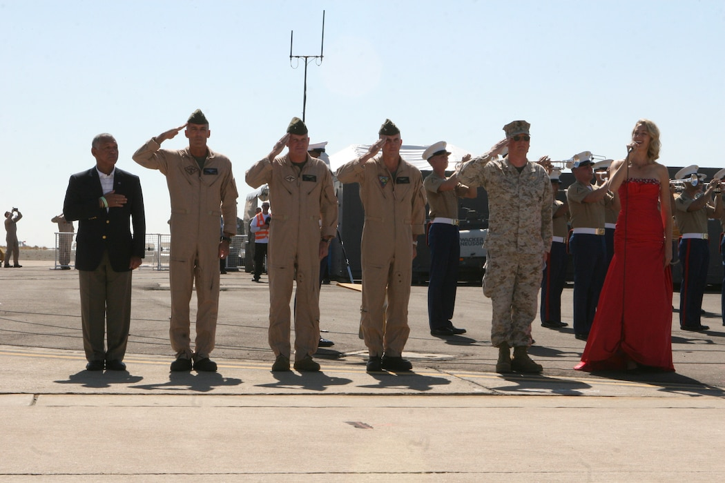 Honored guests salute during the National Anthem at the 2012 Marine Corps Air Station Miramar Air Show, Oct. 13. During the ceremony the station commanding officer and the 3rd MAW commanding general gave speeches followed by a performance from the band.