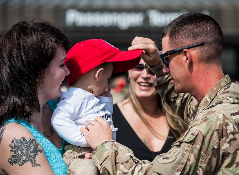Senior Airman Michael Blankenship, 560th Red Horse Squadron, Embraces his wife Krystal and son Landon after returning from the unit's first six month deployment April, 11, 2013, at Joint Base Charleston, S.C.  The Air Force Reservists have been deployed as part of the the 557th Expeditionary RED HORSE Squadron since November and were responsible for heavy construction projects at various Middle Eastern locations. (U.S. Air Force photo/ Senior Airman Dennis Sloan)