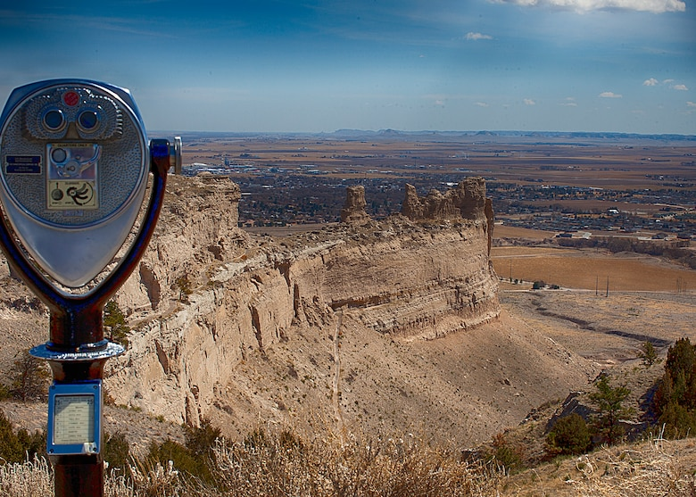 Chimney Rock can be seen on the horizon with the town of Gering, Neb.  in the foreground from the summit of Scotts Bluff National Monument. (U.S. Air Force photo by Matt Bilden)