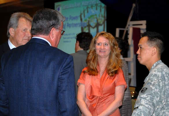 "Following ""The Power of Partnerships"" conference, Col. Mark Toy, commander of the Corps' Los Angeles District, converses with (l to r) Phil Anthony, chair of SAWPA and a member of the Board of Directors of the Orange County Water District, Mike Marcus, general manger of the Orange County Water District, and Celeste Cantu, general manager for SAWPA. The Santa Ana Watershed Project Authority sponsored the conference held April 11 in Costa Mesa, Calif."