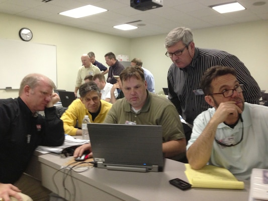From left:  Jason Adams, Larry McIntosh, Blaine Guidry, Garry Runyans and Raul Alonso work on a community group site design during a four-day training session to become Level 2 certified members of Huntsville Center's Housing Planning and Response team. Training was April 2-5, 2013, in Suffolk, Va.