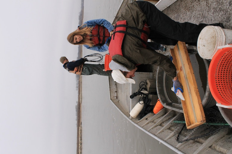 Omaha District Leadership Development Program participant and Realty Specialist Candace Akins looks on as LDP participant and Engineer Josh Melliger measures a shovelnose sturgeon during pallid sturgeon broodstock collection efforts with the Nebraska Game and Parks Commission on the Missouri River, April 8.