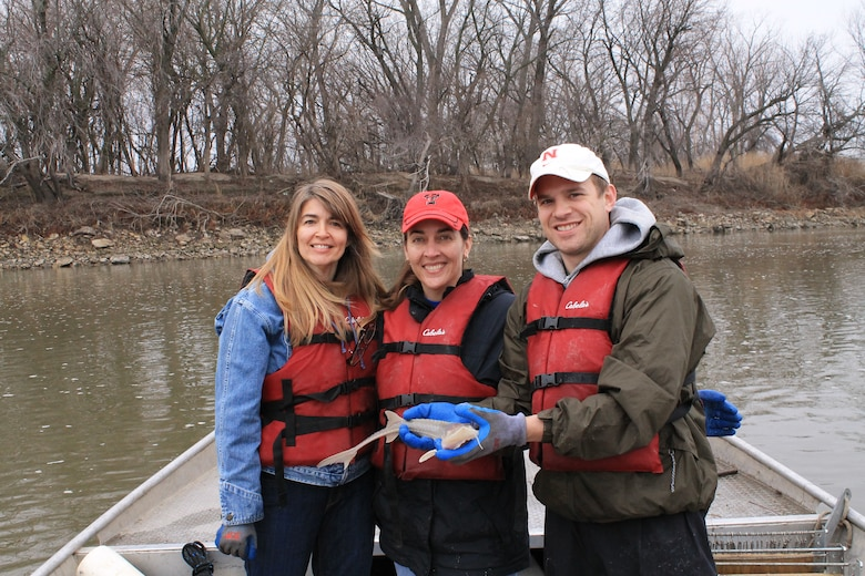 Omaha District Leadership Development Program participants, Candace Akins, Eileen Williamson and Josh Melliger display the pallid sturgeon they caught during broodstock collection efforts with the Nebraska Game and Parks Commission, April 8. The pallid sturgeon measured 585 millimeters long and weighed 735 grams – not big enough to be reproduction-ready. It was returned to the river with the rest of the catch. A pallid should be at least 800 mm long before it is shipped to the hatchery.