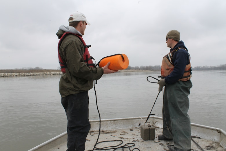 Trotlines are reset with anchors and buoys marking each end of the line during pallid sturgeon broodstock collection with the Nebraska Game and Parks Commission on the Missouri River, April 8.