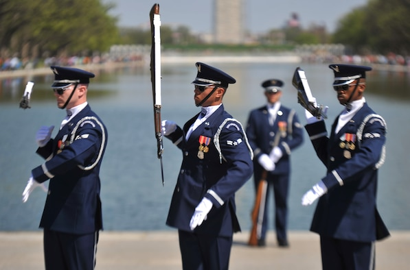 The U.S. Air Force Honor Guard Drill Team spin their M-1 Garand rifle during a performance April 13, 2013, at the National Cherry Blossom Festival in Washington, D.C. The Drill Team members can spin their rifles in speeds of more than forty miles per hour. (U.S. Air Force photo/Airman 1st Class Alexander Riedel)