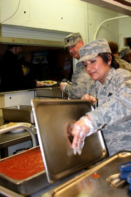 Senior Master Sgt. Annie Menchaca-Bratton prepares food for the homeless at the Cherry Street Mission, Toledo, Ohio as part of a community outreach project with the 180th Fighter Wing's Logistics Readiness Squadron in February. (Courtesy Photo/Released).