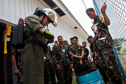 U.S. Marine Lance Cpl. Matthew D. Bell straps on a power hawk rescue system battery pack while explaining its capabilities to Filipino firefighters at Clark Field, Philippines, April 8. Marine firefighters demonstrated the capabilities of their rescue equipment to Filipino firefighters to better prepare both militaries for potential accidents. The training was part of exercise Balikatan 2013, an annual bilateral training evolution aimed at ensuring interoperability of the Philippine and U.S. militaries during planning, contingency and humanitarian assistance operations.