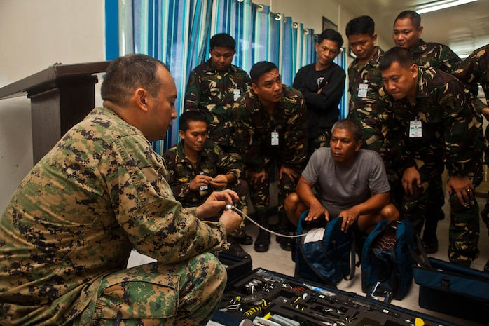 U.S. Marine Staff Sgt. Jose Acevedo explains the use of equipment from the HAL hook and line system, used for basic rigging and transporting, to Filipino explosive ordnance technicians at Clark Field, Republic of the Philippines, April 10. EOD technicians with the Philippine Air Force and the U.S. Marine Corps trained together during exercise Balikatan 2013, an annual bilateral exercise in its 29th iteration that is aimed at ensuring interoperability of the Philippine and U.S. militaries during planning, contingency and humanitarian assistance operations. Acevedo is an EOD technician with Marine Wing Support Squadron 172, 1st Marine Aircraft Wing, III Marine Expeditionary Force.