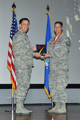 NELLIS AIR FORCE BASE, Nev. -- (Right) Master Sgt. Cal, 78th Attack Squadron, receives the award for 926th Group First Sergeant of the Year from Col. John Breeden, 926th Group commander, here April 6. (U.S. Air Force photo/Maj. Jessica Martin)