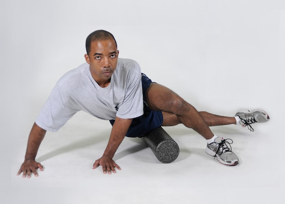 IT-Band Foam Roll Lie on the body's right side, place the right hip on a foam roller and put hands on the floor for support. Cross the left leg over the right leg and place the left foot flat on the floor. Roll the body forward and backward in small movements until the roller reaches just above the knee. Repeat on other side.