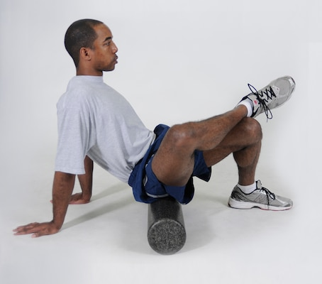 Glutes Foam Roll Sit on a foam roller with it positioned on the right glute. Cross the right leg over the front of the left thigh and put hands on the floor for support. Roll the body forward and backward in small movements from the lower glute to the upper glute. Repeat with the roller under the left glute.