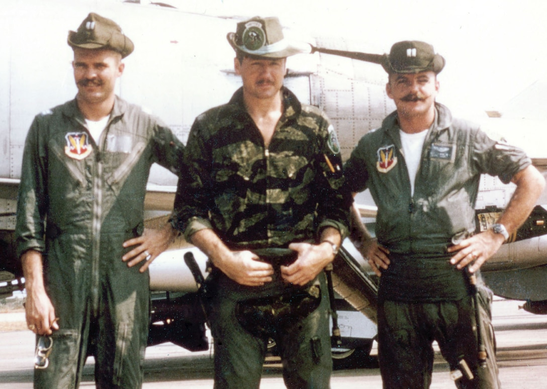 "469th TFS pilots Capts. Bruce Holmes, (left to right) Will Koenitzer and William ""Bart"" Barthelmas. Barthelmas was killed in action on July 27, 1965, on the first Air Force airstrike against North Vietnamese surface-to-air missile sites. (U.S. Air Force photo)"