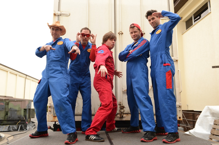 SPANGDAHLEM AIR BASE, Germany – Members of the Imagination Movers group pose for a photo at the Skelton Memorial Fitness Center April 11, 2013. Imagination Movers is an educational children's band that began in 2003 when a group of friends decided to write songs after putting their children to bed. Spangdahlem was the first stop for the Armed Forces Entertainment and the U.S. Navy-sponsored tour through Europe. (U.S. Air Force photo by Airman 1st Class Kyle Gese/Released)