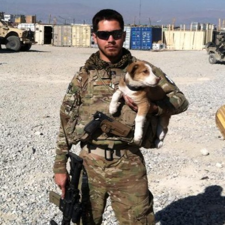 Staff Sgt. Thomas Burright, 7th Logistics Readiness Squadron, poses for a photo with his dog Lyla during his recent deployment to Afghanistan. Embedded as a vehicle mechanic with a unit of Army Green Berets, Burright was the only Air Force servicemember stationed at their outpost. (Courtesy photo)