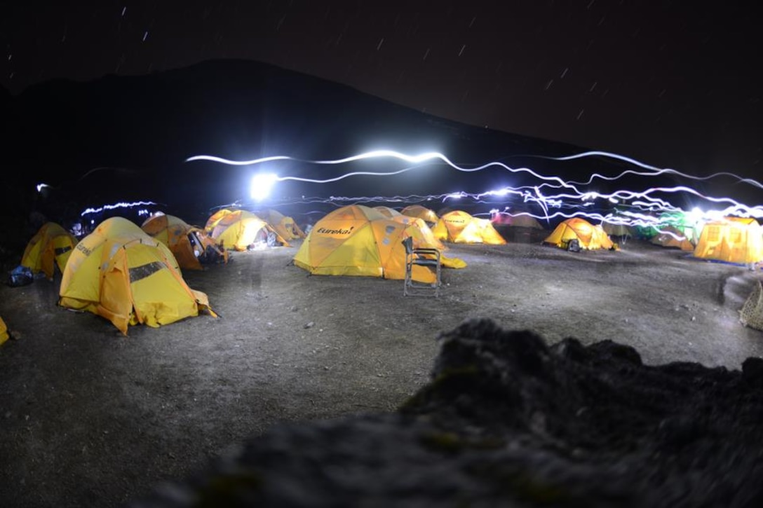 The tents of the U.S. Air Force Seven Summit team are illumated at night at a base camp near Mount Everest. A team of six active-duty Airmen is currently on their way to climb Mount Everest, the highest mountain on Earth, to suppoort resilience, raise money for charity and commemorate their fallen. (Courtesy photo/USAF Seven Summit Challenge)