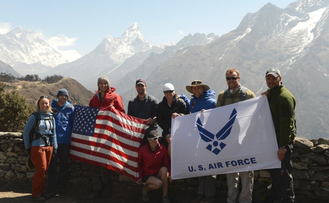 Part of the U.S. Air Force Seven Summit team smiles for a group photo in front of a Himalayan mountain range in Deboche, Nepal. A team of six active-duty Airmen is currently on their way to climb Mount Everest, the highest mountain on Earth. (Courtesy photo/USAF Seven Summit Challenge)