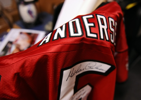 SPANGDAHLEM AIR BASE, Germany – An autographed Morten Andersen jersey hangs on a chair April 10, 2013. Andersen, a kicker, is the all-time leading scorer in NFL history. The jersey is part of the Operation Warm Heart silent auction 10 a.m. – 6 p.m., May 31 in the Brick House. U.S. Air Force Master Sgt. Anthony Mitchell, 52nd Logistics Readiness Squadron assistant first sergeant and Spangdahlem First Sergeant Council fundraising chairperson, created the auction to raise funds for the program. (U.S. Air Force photo by Staff Sgt. Daryl Knee/Released)