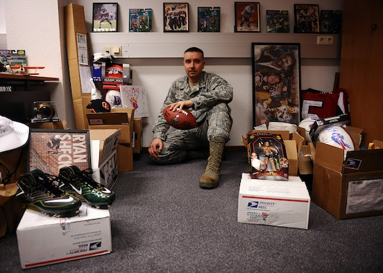 SPANGDAHLEM AIR BASE, Germany – U.S. Air Force Master Sgt. Anthony Mitchell, 52nd Logistics Readiness Squadron assistant first sergeant and Spangdahlem First Sergeant Council fundraising chairperson, sits among boxes of donated sports and TV memorabilia April 10, 2013. Mitchell began gather the memorabilia in January for a silent auction May 31 at the Brick House. The funds raised will go toward Operation Warm Heart, a program designed to help offset the needs of Airmen facing emergency-related financial hardships. (U.S. Air Force photo by Staff Sgt. Daryl Knee/Released)