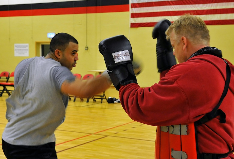 Staff Sgt. David Meredith, 721st Aerial Port Squadron security manager, spars against James Scullion, Celtic Warrior Boxing Club coach, during practice, Feb. 27, 2013, Miesau Army Depot, Germany. The combination of cardio, cross training and strength training makes boxing a great alternate workout for any fitness level. (U.S. Air Force photo/Airman 1st Class Trevor Rhynes)