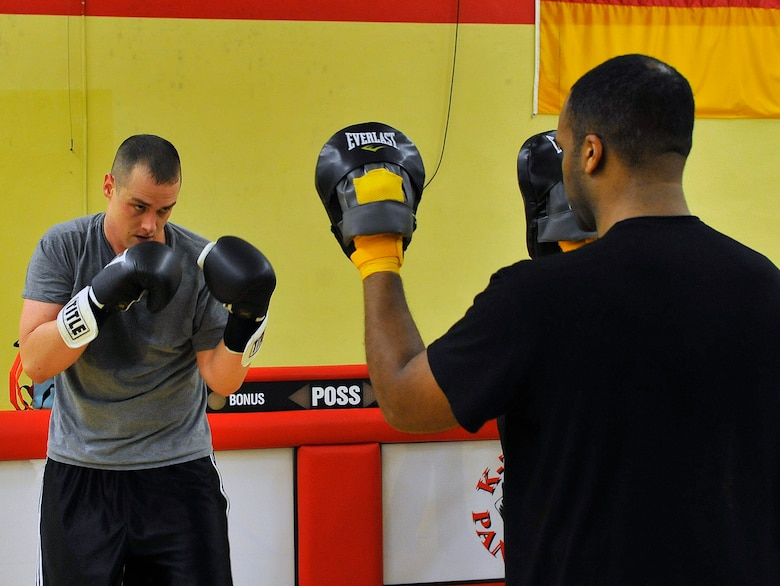 Staff Sgt. Stephen Basham, 693rd Intelligence Support Squadron plans and integrations, spars with Tech. Sgt. Thaddaus Zeno, 693rd Intelligence Support Squadron SIGNT systems NCOIC, Feb. 27, 2013, Miesau Army Depot, Germany. The combination of cardio, cross training and strength training makes boxing a great alternate workout for any fitness level. (U.S. Air Force photo/Airman 1st Class Trevor Rhynes)