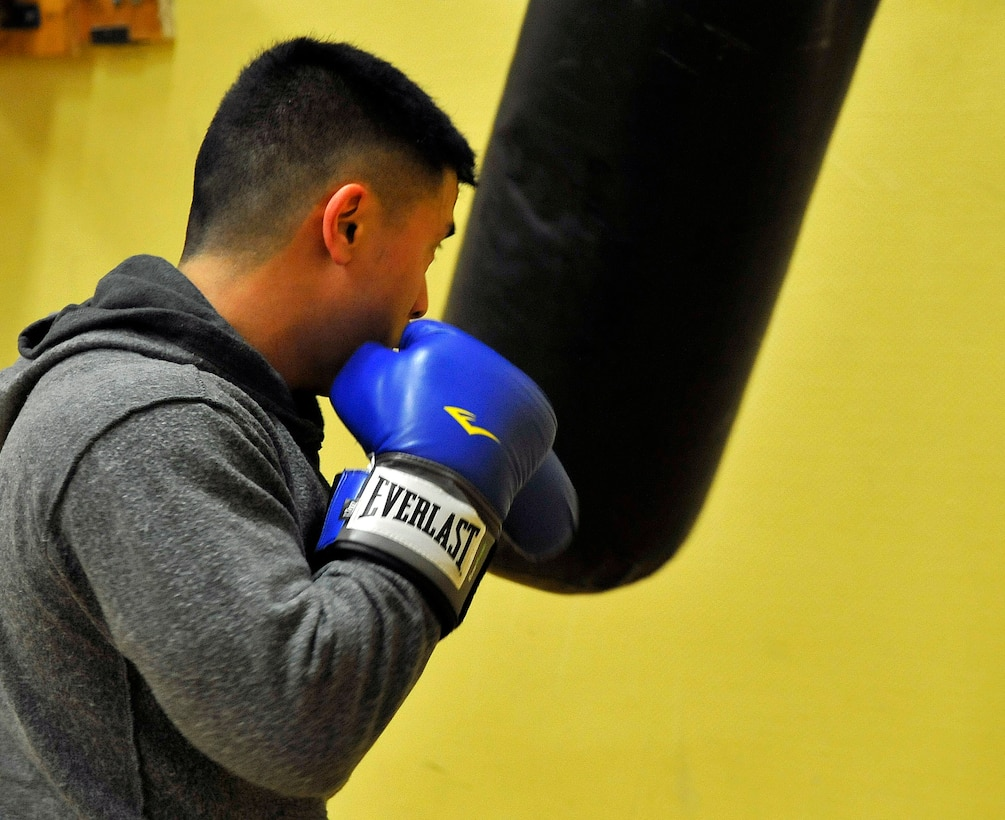 Capt. Larry Cornelio,786th Civil Engineer Squadron Kaiserslautern Operations Flight commander, trains on the heavy punching bag, Feb. 27, 2013, Miesau Army Depot, Germany. The combination of cardio, cross training and strength training makes boxing a great alternate workout for any fitness level. (U.S. Air Force photo/Airman 1st Class Trevor Rhynes)