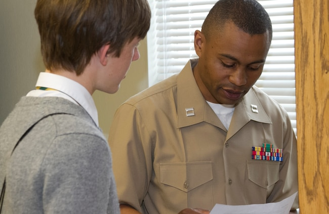 Capt. Toussaint J. Jackson, an instructor with The Basic School in Marine Corps Base Quantico, Va., speaks with a student during a Marine Corps Leadership Seminar aboard Wake County Young Men's Leadership Academy in Raleigh, N.C., April 11. The Marine Corps Leadership Seminar has been hosted by colleges and universities across the country for the past three years; however, this is the first time the event has been hosted at a high school.
