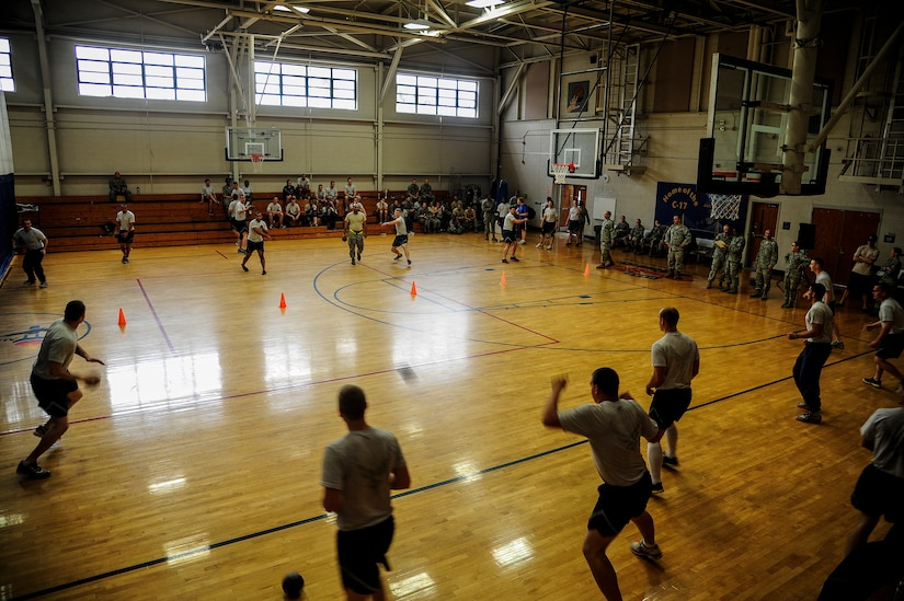 Airmen from the Joint Base Charleston – Air Base dorms scramble to take out their opponents during the Dorm Challenge dodgeball game April 12, 2013, at the Fitness Center at JB Charleston, S.C. The quarterly Dorm Competition is a Wing initiative intended to encourage and incorporate all aspects of Comprehensive Airman Fitness, while encouraging resident interaction and camaraderie. The Dorm Challenge consisted of push-ups, sit-ups, cornhole and a game of dodgeball. (U.S. Air Force photo/Staff Sgt. Rasheen Douglas)