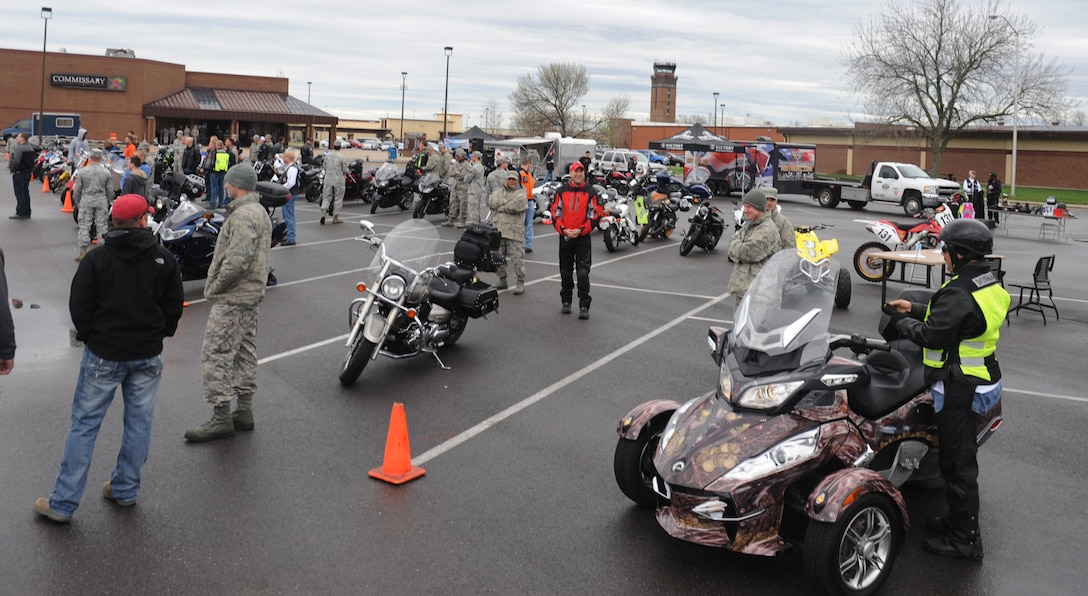 Members of Team Whiteman participate in the annual Motorcycle Awareness and Safety Day at Whiteman Air Force Base, Mo., April 15, 2013. The event was held in the commissary parking lot to raise awareness for safe motorcycle riding practices. (U.S. Air Force photo by Airman 1st Class Bryan Crane/Released)