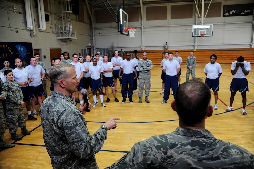 Col. Darren Hartford, 437th Airlift Wing commander, speaks to  participants of  the Dorm Challenge April 12, 2013, at the Fitness Center at Joint Base Charleston - Air Base, S.C. The quarterly dorm competition is a Wing initiative intended to encourage and incorporate all aspects of Comprehensive Airman Fitness while encouraging resident interaction and camaraderie. The Dorm Challenge consisted of push-ups, sit-ups, cornhole and dodgeball. (U.S. Air Force photo/Staff Sgt. Rasheen Douglas)