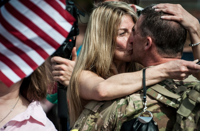 Chief Master Sgt. James Donnelly, 560th Red Horse Squadron kisses his fiancé after returning from the unit's first six-month deployment to the Southwest Asia region April 11, 2013, at Joint Base Charleston – Air Base, S.C. The group arrived back home to a cheering crowd of family and friends. (U.S. Air Force photo/ Senior Airman Dennis Sloan)