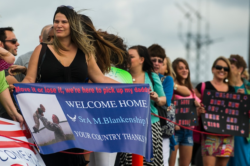 Tawnya Stephen waits for her son-in-law, Senior Airman Michael Blankenship, 560th Red Horse Squadron structural engineer, to exit a plane after he returned home from deployment to the Southwest Asia region April 11, 2013, at Joint Base Charleston – Air Base, S.C. The group arrived back home to a cheering crowd of family and friends. (U.S. Air Force photo/ Senior Airman George Goslin)